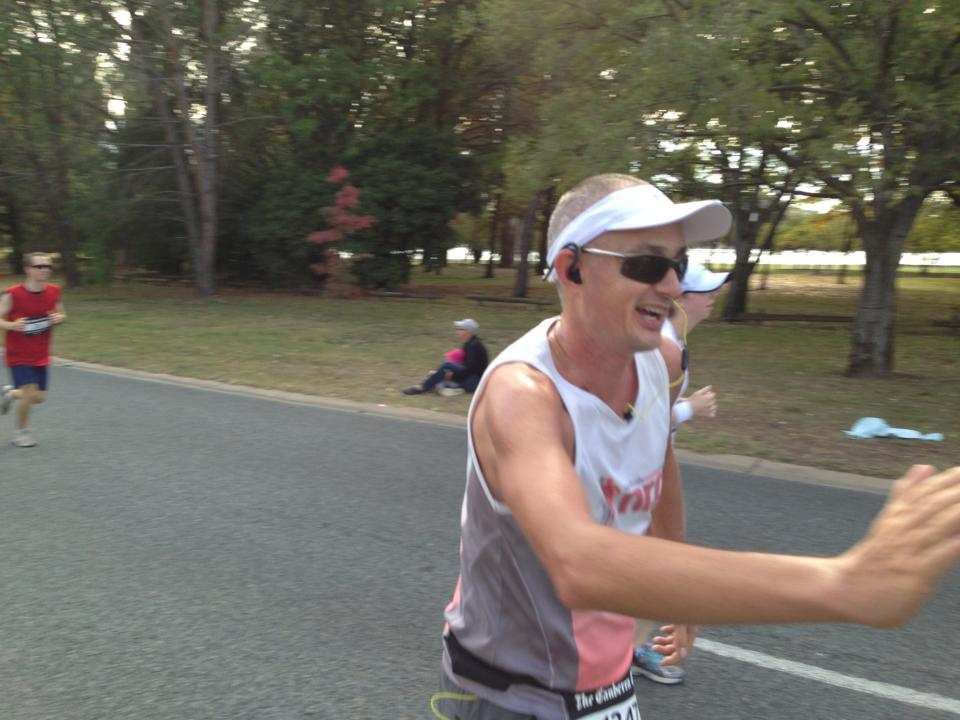That's me giving a high 5, about 10km before getting smacked hard by this race