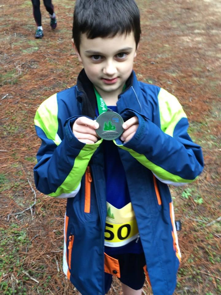Alex 1km medal